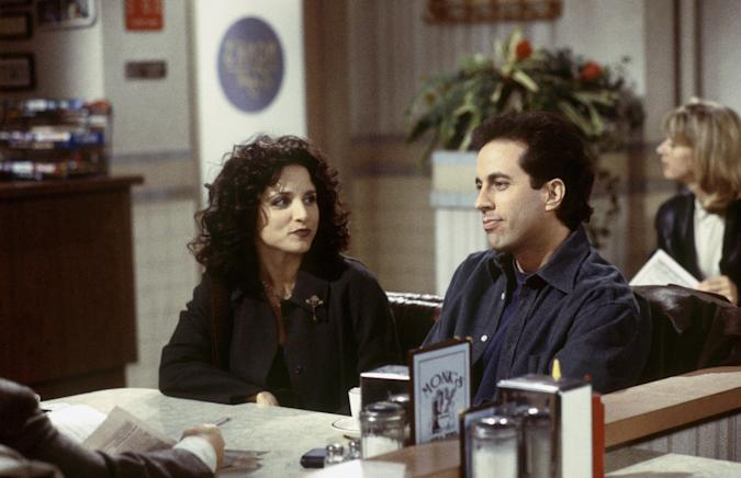 """SEINFELD -- """"The Wizard"""" Episodic 15 -- Pictured: (l-r) Julia Louis-Dreyfus as Elaine Benes, Jerry Seinfeld as Jerry Seinfeld -- Photo by: Joesph Delvalle/NBCU Photo Bank"""