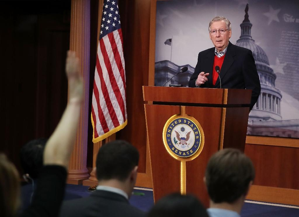 "Senate Majority Leader Mitch McConnell told reporters, ""The Russians are not our friends"" (AFP Photo/MARK WILSON)"