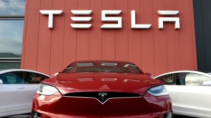 Tesla posts surprise 3Q profit, stock surges