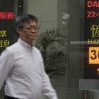 Global stocks advance but trading slows ahead of US holiday