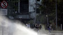 Indonesia police use tear gas, water cannon to disperse protests - witness