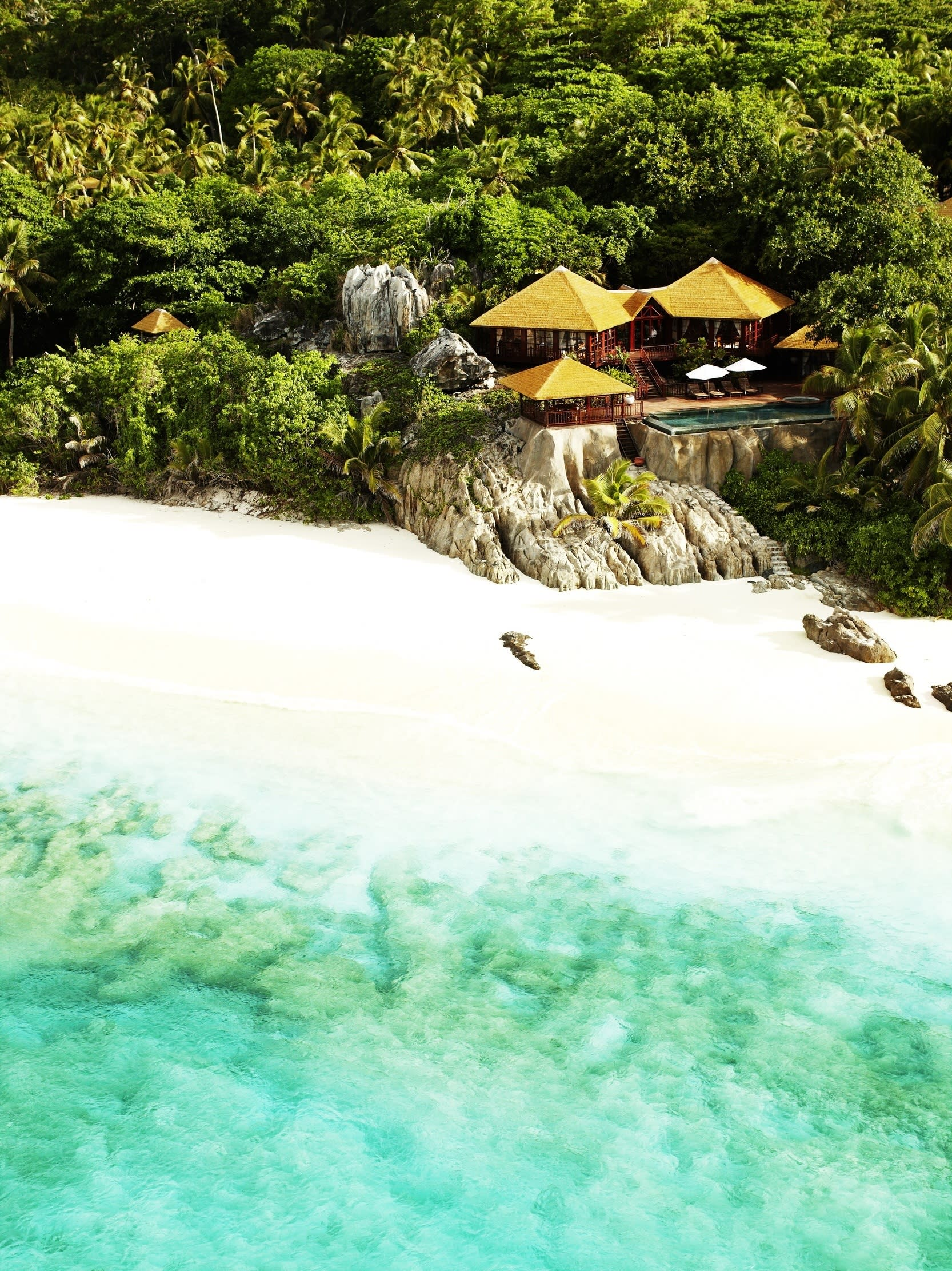 """Famous for its beauty and glorious beaches, <a href=""""http://www.fregate.com/"""" target=""""_blank"""">Fregate Island Private</a> has seven private beaches with their own unique character and can be reserved simply with a 'Beach Occupied' sign. The luxury retreat in the Seychelles occupies an entire private island in the middle of the turquoise Indian Ocean. Beautifully crafted and nestled into the coastline, its 16 residences are naturally secluded – all have their own luxurious terrace, large private infinity pool and Jacuzzi. The resort is also a jewel of conservation in the Seychelles: it is home to the second largest population of Giant Aldabra Land Tortoises and is the nesting home to endangered turtle species. Book a Private Pool Residence from €4,400 per residence per night on an all-inclusive basis."""