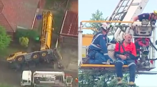 Incredible escape as crane topples, missing house by metres