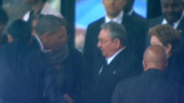 Obama, Raul Castro shake hands; ignite both hope and anger