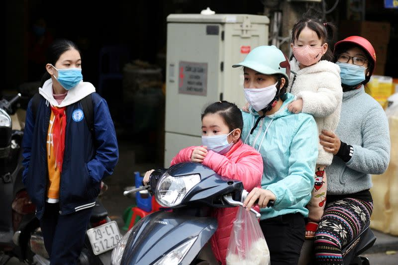 Vietnam curbs movement in southern areas as COVID-19 cases hit record
