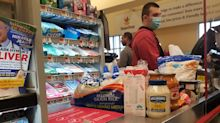 Health officials say Americans should limit grocery store and pharmacy trips or 'we can have another peak in a few weeks'