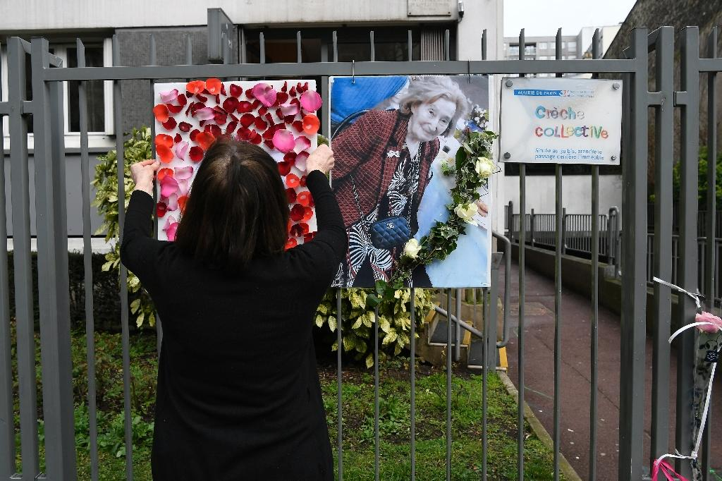 Tributes were placed next to a picture of Mireille Knoll on the fence around her apartment building in Paris, after she was found dead in her apartment on March 23 by firefighters called to extinguish a blaze (AFP Photo/Lionel BONAVENTURE)
