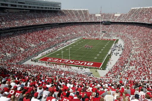 FILE - In this Sept. 3, 2011, file photo, fans fill Ohio Stadium as Ohio State takes on Akron in the second half of an NCAA college football game in Columbus, Ohio. Ohio State will limit home crowds to about 20,000 and prohibit tailgating if the football season is played this fall. Fans inside Ohio Stadium will be required to wear masks and observe social distancing to help stem the spread of the coronavirus pandemic. (AP Photo/Amy Sancetta, File)