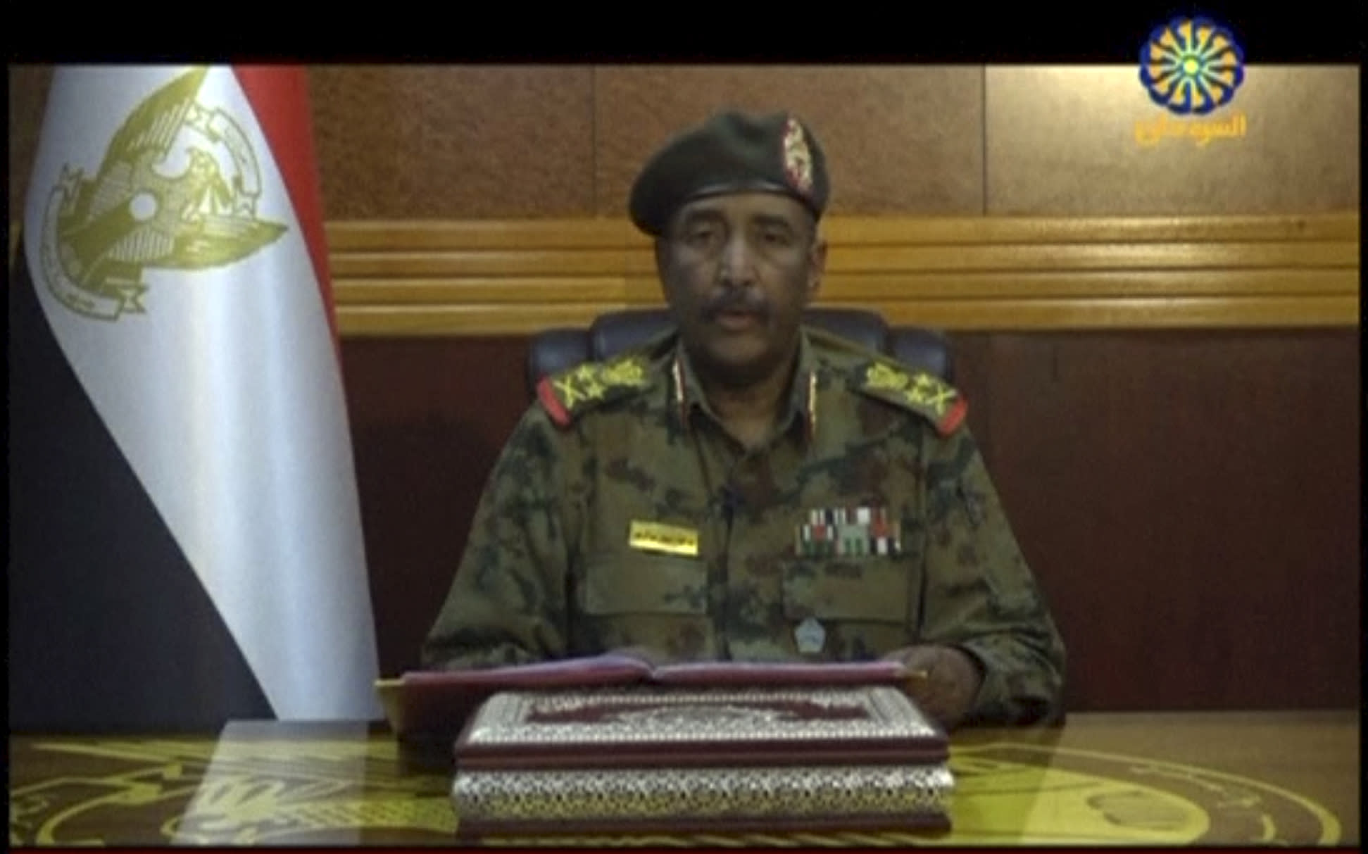 In this frame grab from video provided by Sudan TV, Lieutenant General Abdel-Fattah Burhan, head of the Sudanese Transitional Military Council, TMC, makes a broadcast announcement in Khartoum, Sudan, Tuesday, June 4, 2029. The TMC on Tuesday said that they want to stage early elections in the country and that all agreements with protest leaders have been cancelled. The statement came a day after a pro-democracy sit-in outside the army command base in the capital Khartoum was violently overrun by the ruling army. Protest organizers said 35 people died in the carnage Monday. (Sudan TV via AP)