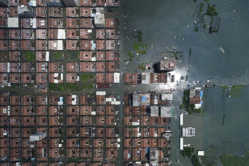 Residential houses submerged in floodwaters following heavy rainfall are seen at a town in Shantou