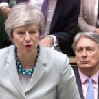 May fights for control as lawmakers aim to seize Brexit process