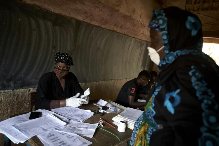The risk of catching coronavirus looms over a parliamentary election in Mali (AFP Photo/MICHELE CATTANI)