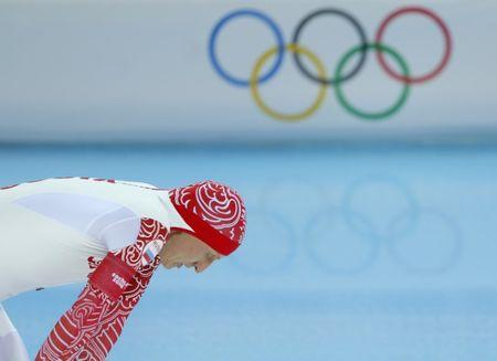 FILE PHOTO - Ivan Skobrev of Russia reacts after his men's 5000 meters speed skating race during the 2014 Sochi Winter Olympics