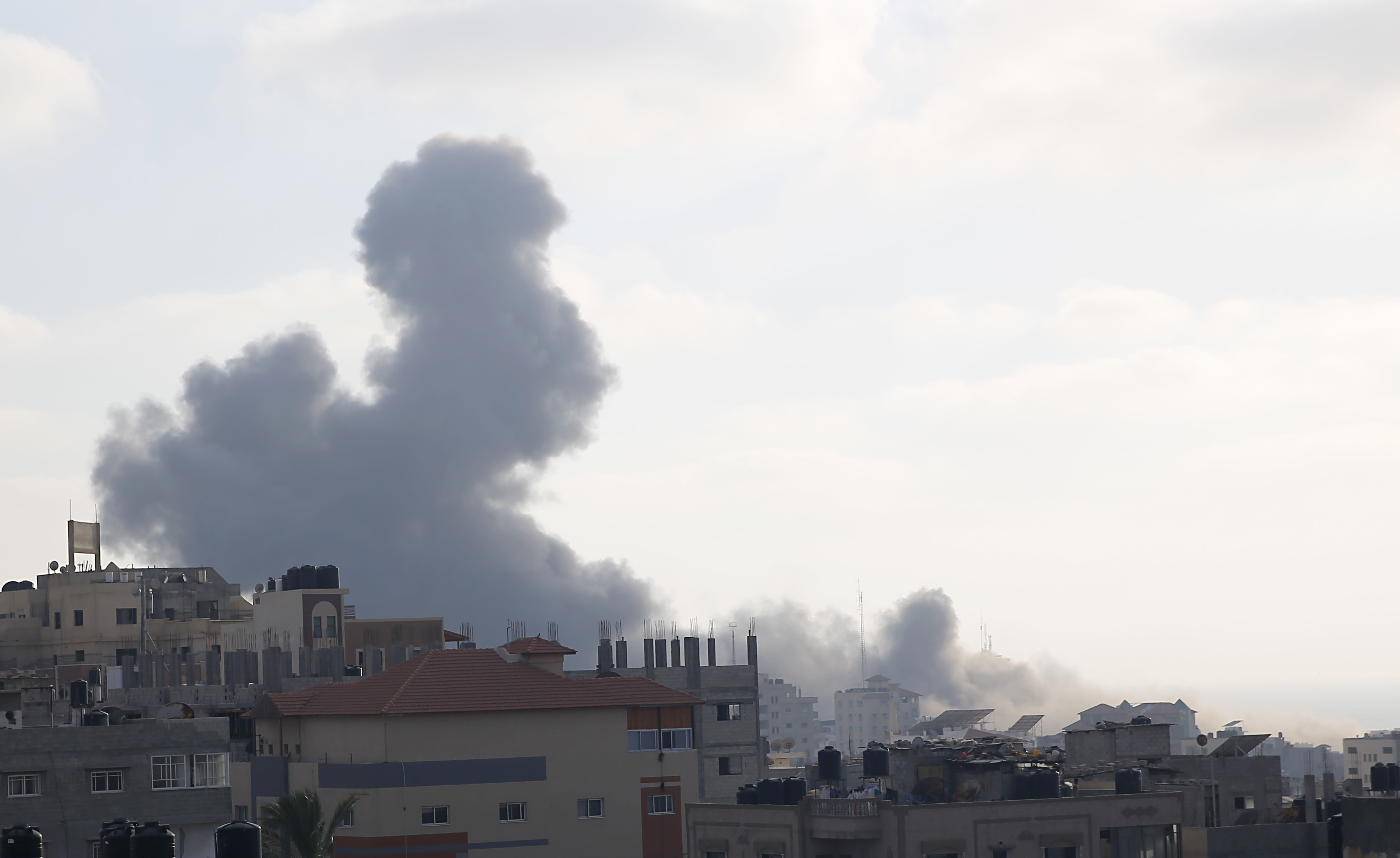 Smoke rises from an explosion caused by an Israeli airstrike in Gaza City, Thursday, Aug. 9, 2018. Israeli warplanes have hit dozens of targets in the Gaza Strip, while Palestinian militants fired scores of rockets into Israel in a fierce burst of violence overnight that came as Egypt was trying to broker a long-term cease-fire between the sides. (AP Photo/Hatem Moussa)