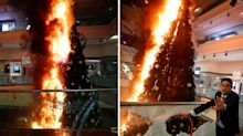 'Total breakdown': Scary moment giant Christmas tree set on fire in luxury mall