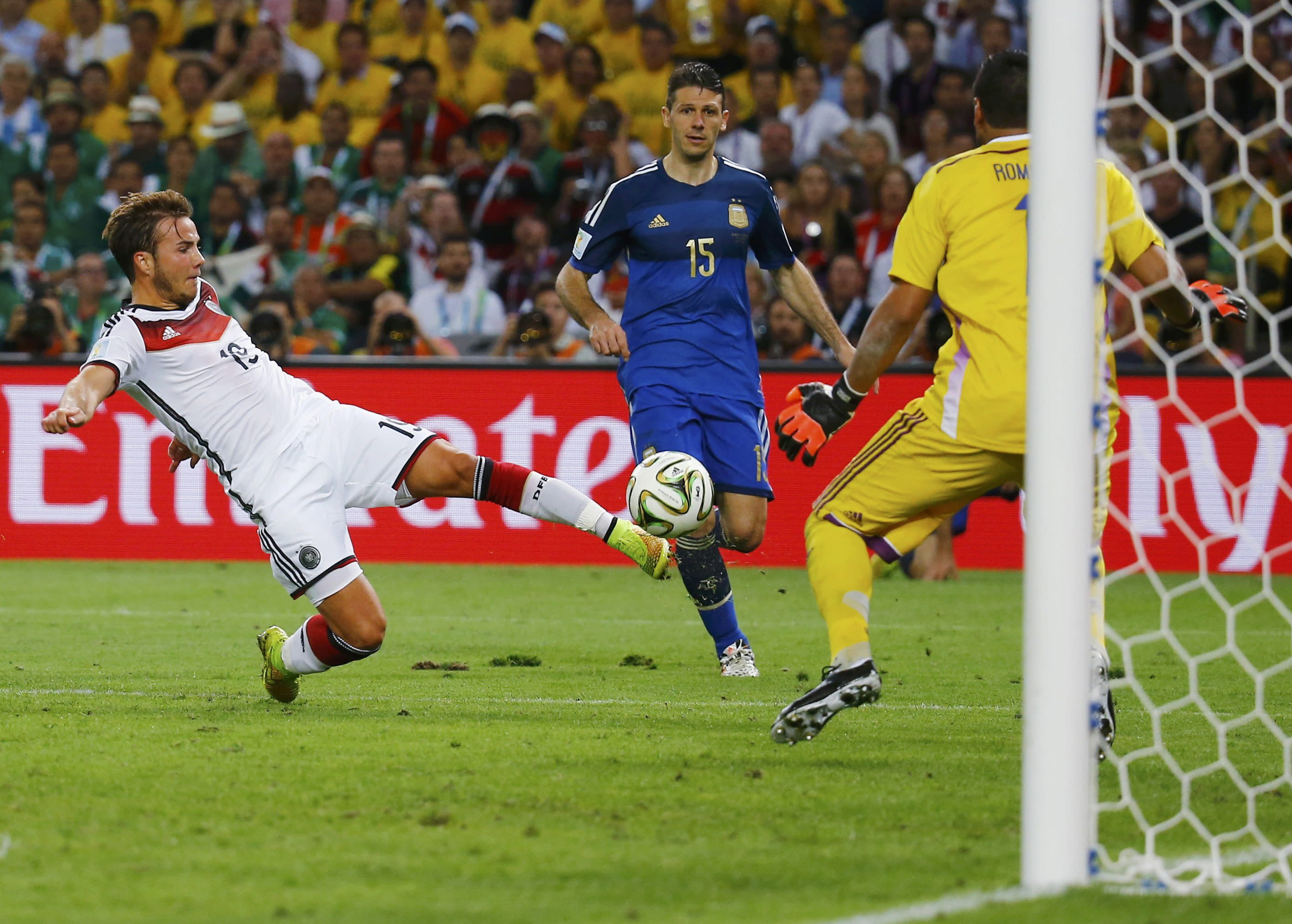 Germany's Mario Goetze shoots to score a goal past Argentina's goalkeeper Sergio Romero during extra time in their 2014 World Cup final at the Maracana stadium in Rio de Janeiro July 13, 2014. REUTERS/Kai Pfaffenbach (BRAZIL - Tags: SOCCER SPORT WORLD CUP TPX IMAGES OF THE DAY) TOPCUP