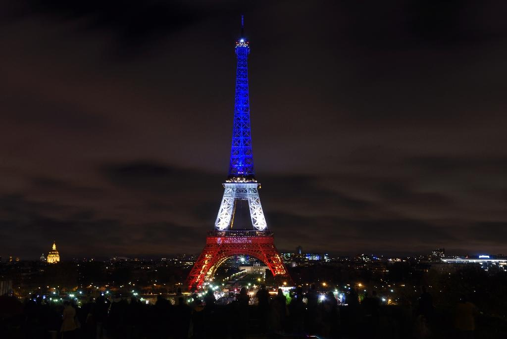 The Eiffel Tower is illuminated with the colours of the French national flag in tribute to the victims of the November 13 Paris terror attacks