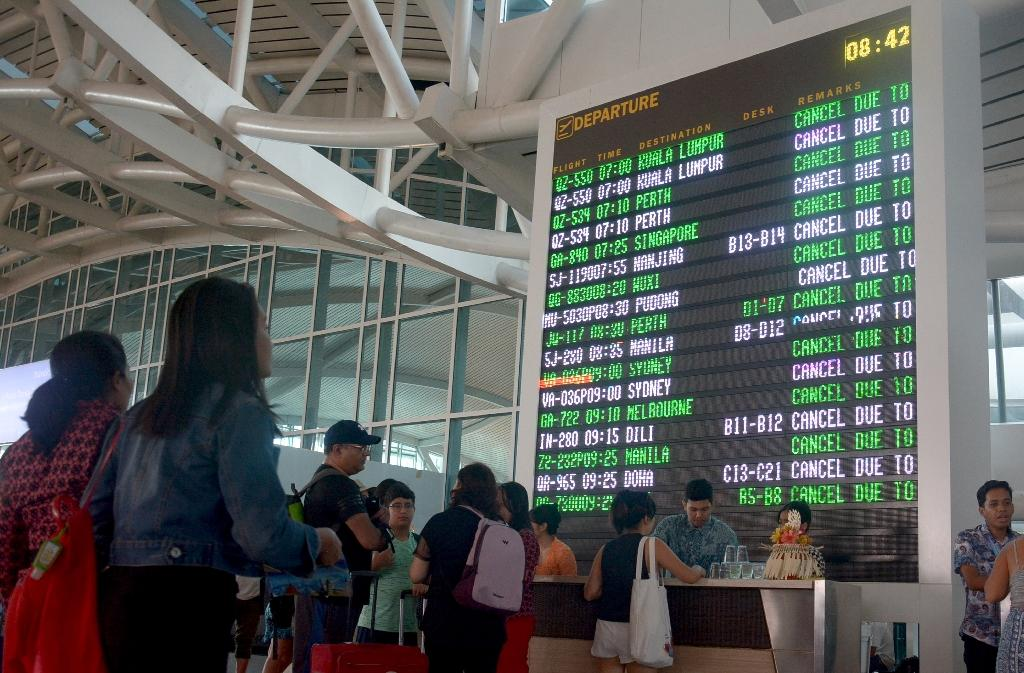 The early morning closure of Ngurah Rai airport sparked the cancellation of nearly 450 flights to and from Bali (AFP Photo/GEDE ARDIASA)