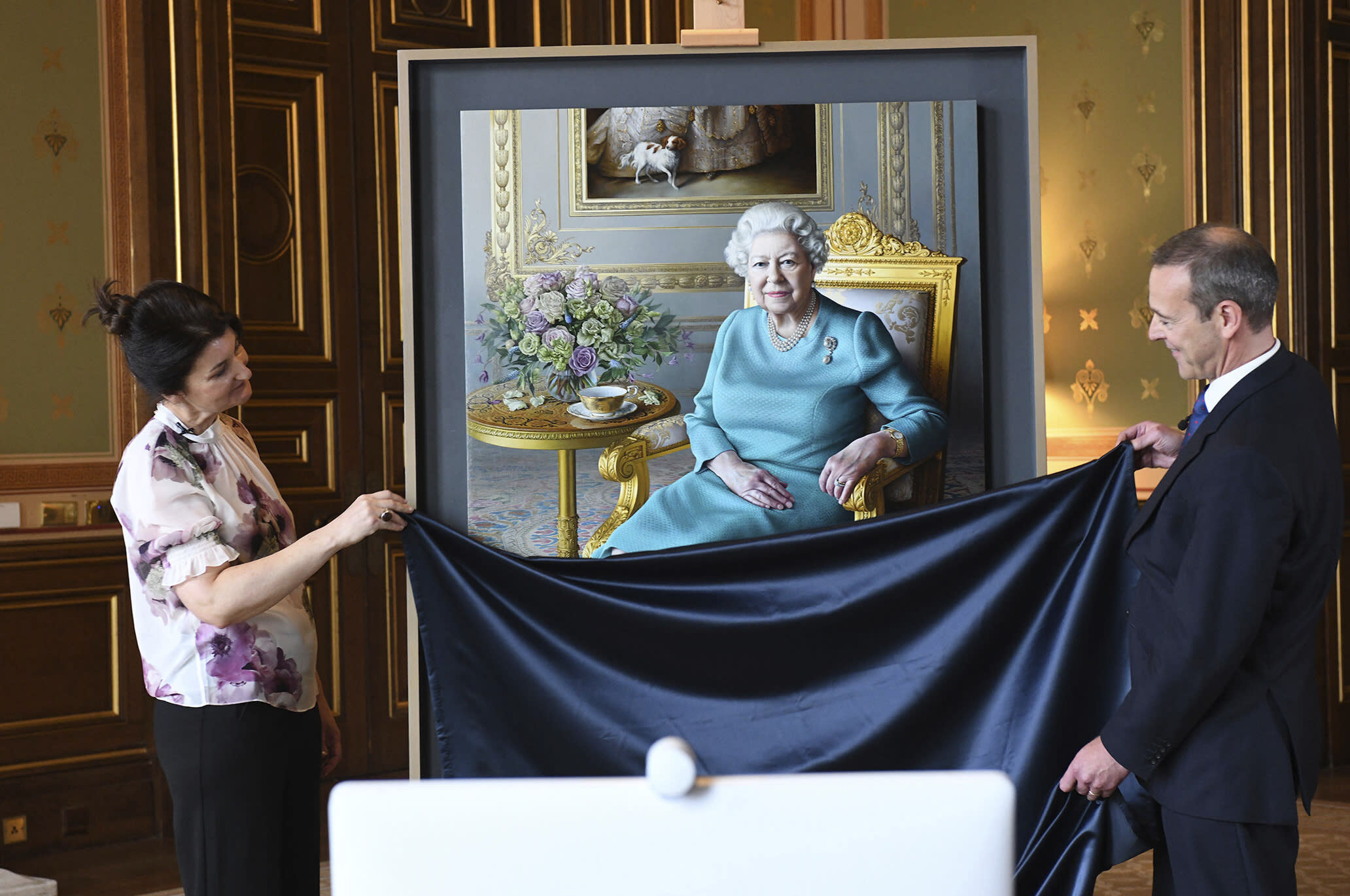 Queen Elizabeth sees new portrait unveiled at Britain's Foreign Office
