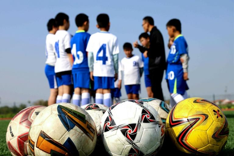 """A coach trains young players in Binzhou in eastern China's Shandong province. """"Football is a beautiful game to educate the new generation of young Chinese,"""" says top CFA official Liu Yi"""