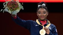 Simone Biles ties record for world medals after winning gold in vault