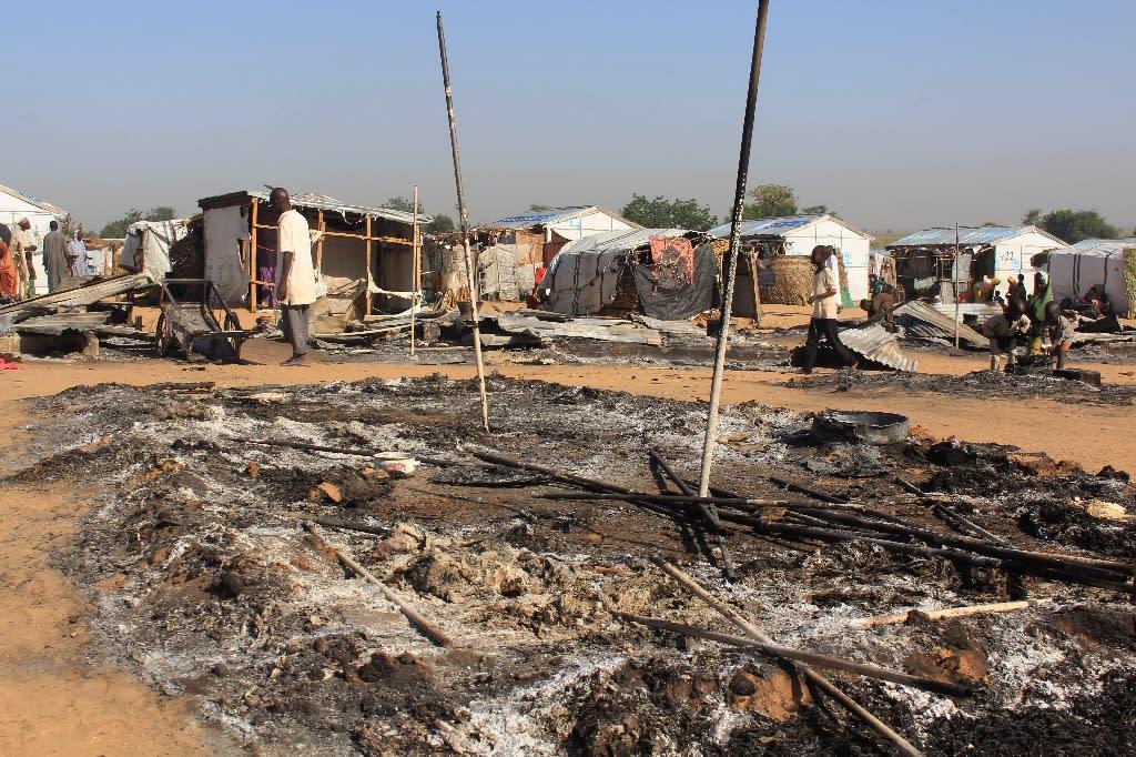 Houses have been left burnt by Boko Haram attacks (AFP Photo/AUDU MARTE)