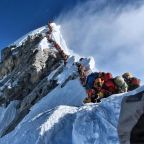 Four climbers die on Everest as record numbers crowd route to summit
