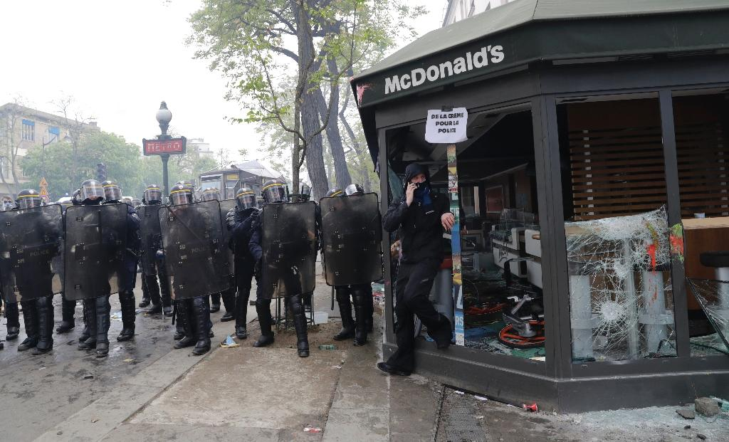 A McDonalds resteraunt was set on fire when May Day rallies turned to chaos in Paris (AFP Photo/Thomas SAMSON)