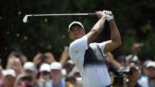 Tiger Woods makes early charge, comes back down to earth on moving day at Quicken Loans National