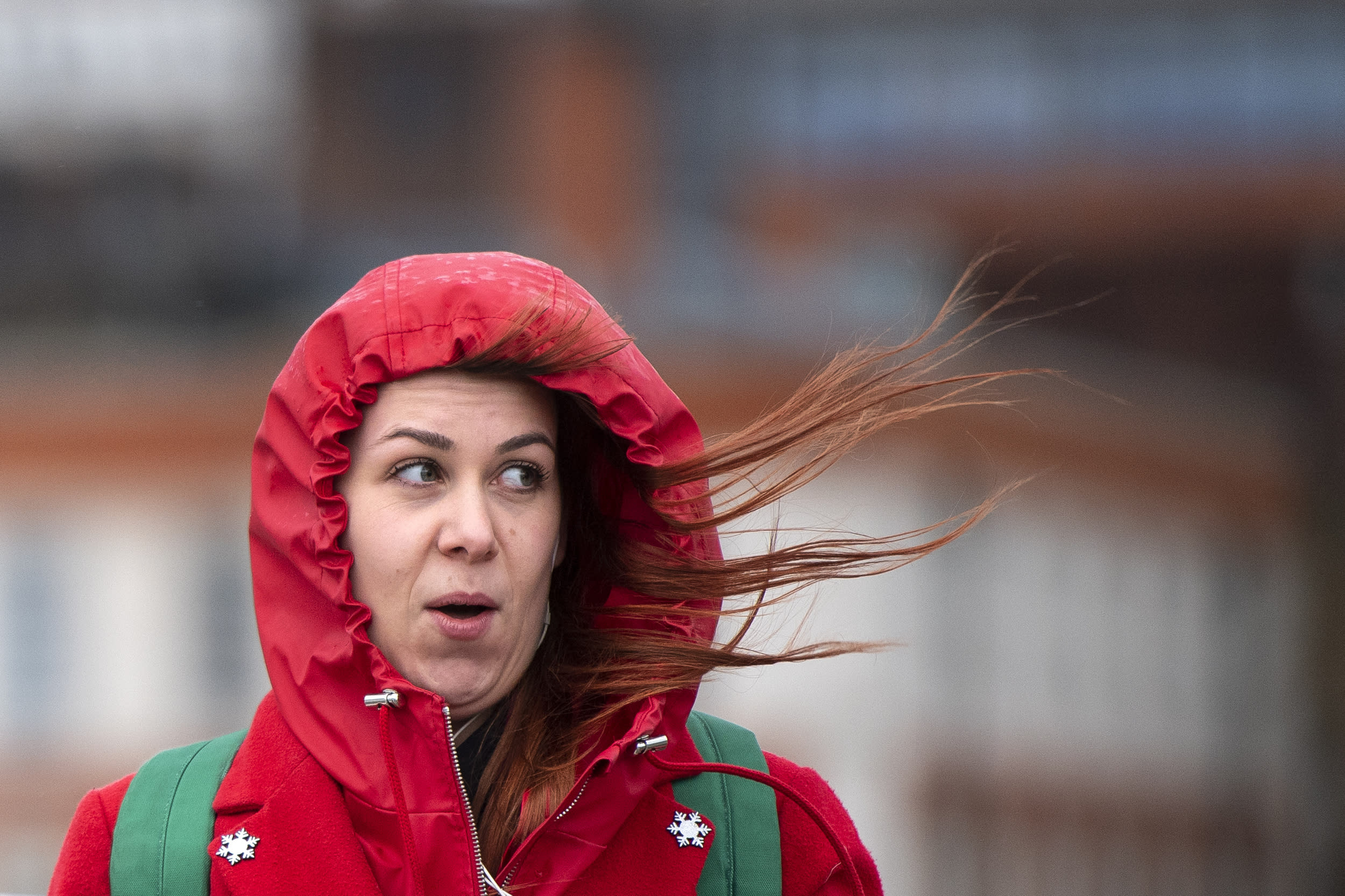 A woman battles against strong winds and rain on Waterloo Bridge in central London, as Storm Erik brought strong winds to parts of the country.