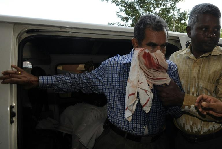 Sri Lankan chief editor of the privately-owned Rivira weekly Upali Tennakoon (L) is rushed to the Colombo national hospital after he was attacked in 2009