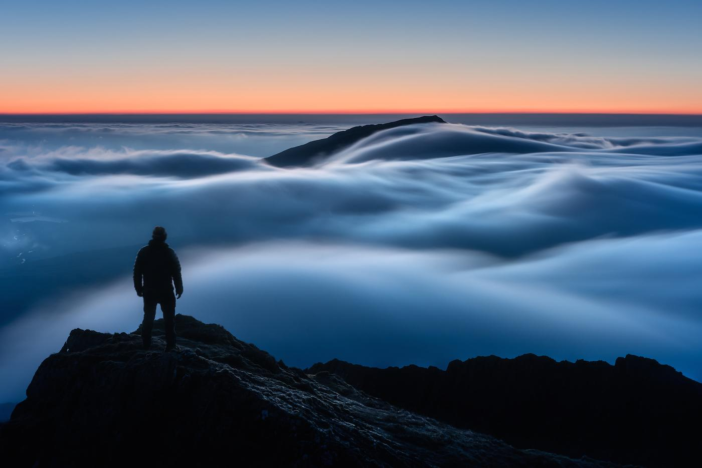 """Overall winner """"Above My Expectations"""", taken by Gareth Mon Jones, shows a blanket of cloud draped across Y Lliwedd, one of the flanks of Snowdon in North Wales (Picture: PA)"""