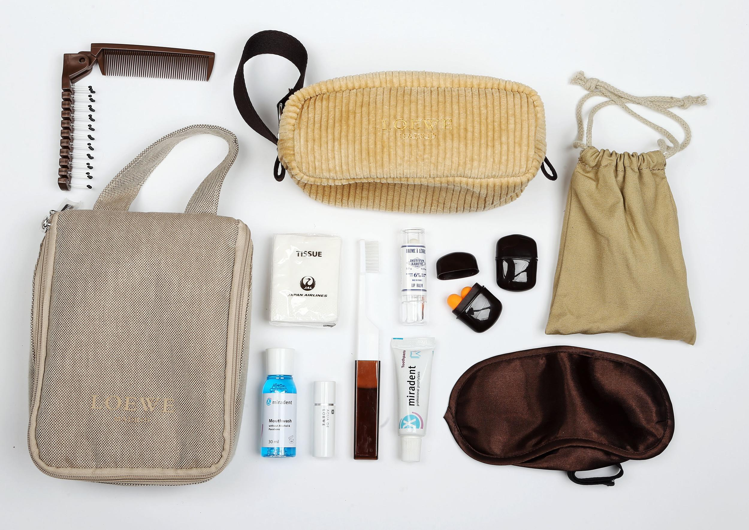 """<p><strong>What do you get?</strong> The outbound kit is a beige that whispers """"high net worth"""" and the items inside are a rich, dark-chocolate brown. They include a foldable comb/brush, tissues, ear plugs, eye mask, toothbrush, toothpaste, mouthwash, unisex Loewe goodies (lip balm, moisture mask and hand towel. Agua de Loewe fragranced).<br /> Inbound, the kit is a rich, beige corduroy with a chocolate brown strap and contains an eye mask, ear plugs, tissues, foldable brush/comb, toothbrush, toothpaste, mouthwash, Institut Karite lip balm, Loewe moisture mask, Japan Airlines moisture mask (think surgical mask)<br /> <strong>Best bit of the kit?</strong> The bags. JAL has thought of everything. They're beautifully engineered with an innovative zip/strap on the camel corduroy one and a hanger in the canvas bag. We're dying to see the moss-green corduroy bag. We'd book flights for it.</p>"""