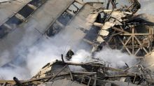 At least 20 firefighters dead in building collapse in Tehran