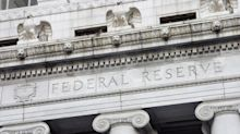 Fed Cuts Rate, Bank Stocks Rally on Divided Future Course
