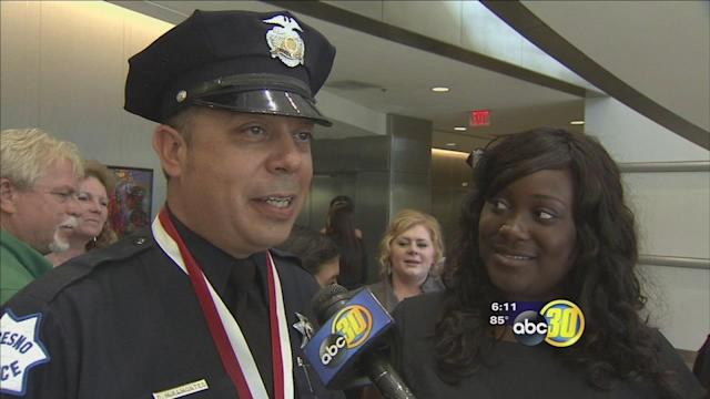 Fresno officers receive a special award from a Macy's worker
