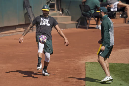 Oakland Athletics' Sean Manaea, left, and Lou Trivino kick a soccer ball during a baseball workout in Oakland, Calif., Monday, Sept. 28, 2020. The Athletics are scheduled to play the Chicago White Sox in an American League wild-card playoff series starting Tuesday. (AP Photo/Jeff Chiu)