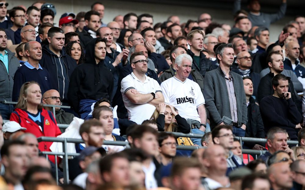 Tottenham fans look dejected against Chelsea at Wembley - PA
