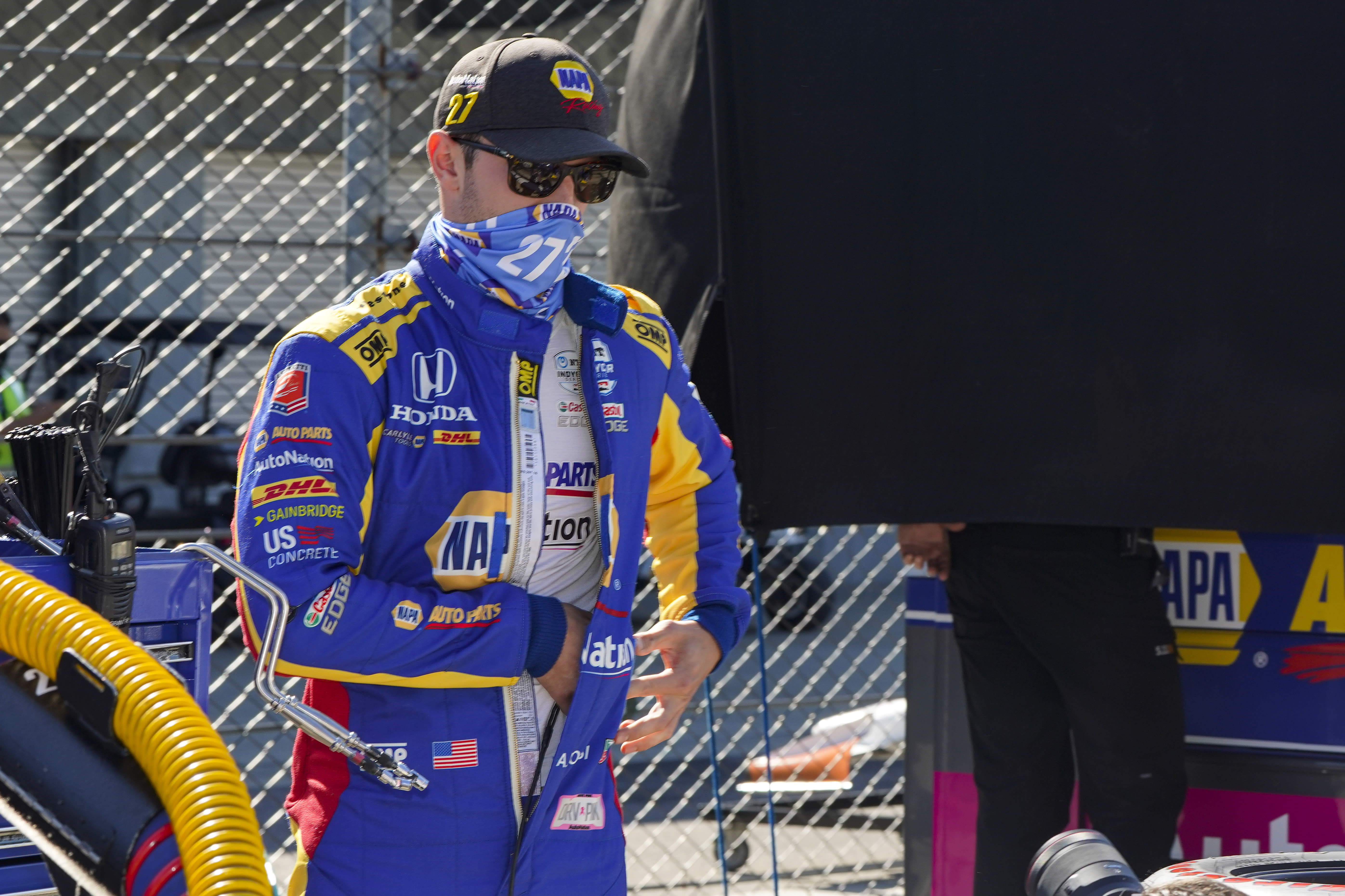 Alexander Rossi prepares to drive before practice for the Indianapolis 500 auto race at Indianapolis Motor Speedway in Indianapolis, Friday, Aug. 21, 2020. The 104th running of the Indianapolis 500 auto race is scheduled to run on Sunday. (AP Photo/Michael Conroy)