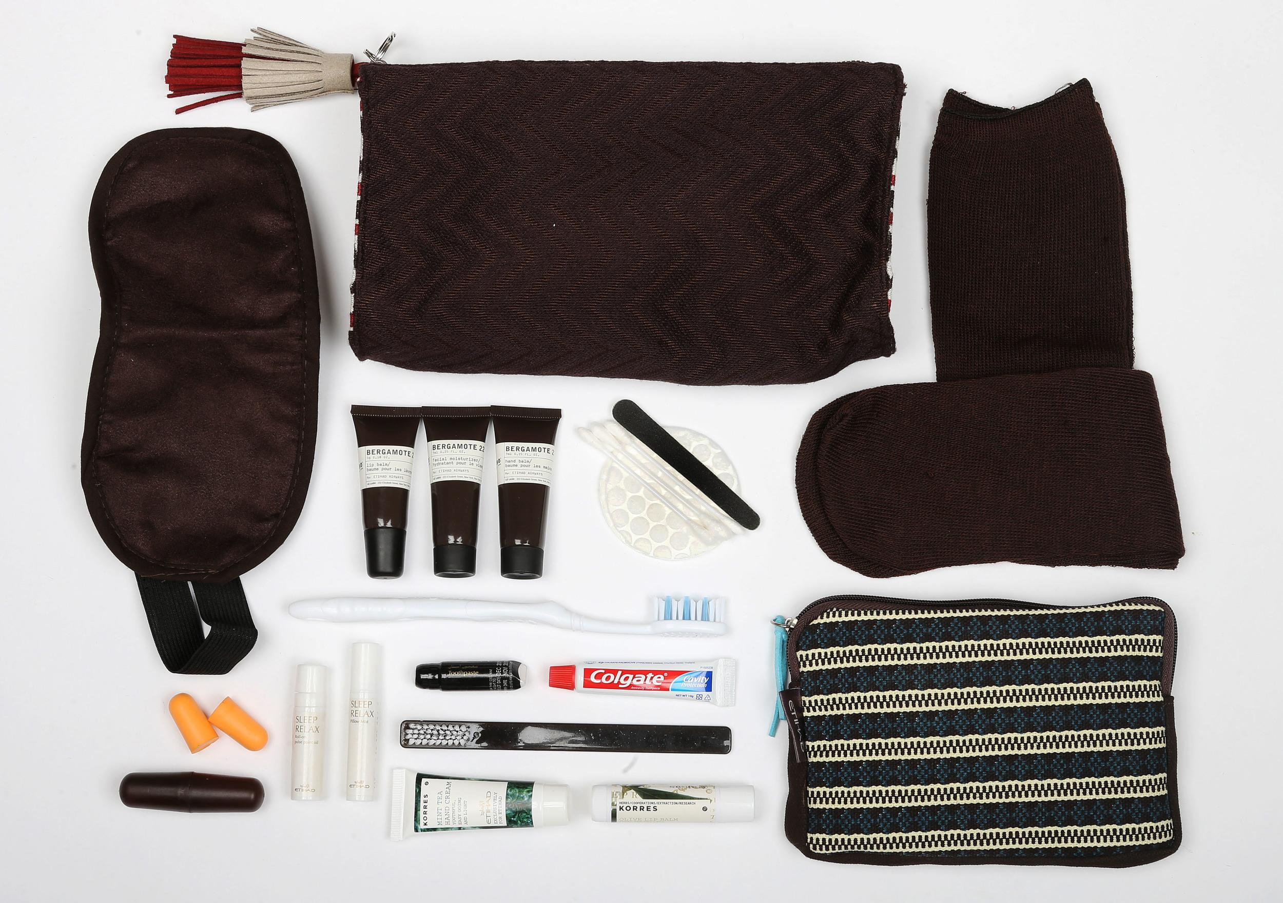 """<p><strong>What do you get?</strong> The Diamond First Class kits: Socks, eye mask, roll-on pulse point oil, pillow mist for a """"good night's sleep"""", toothbrush, toothpaste, cotton buds, make-up pads, emery board, products by Le Labo, the luxury New York brand (lip balm, hand balm and facial moisturiser), shaving kit of Schick razor and tube of shaving cream<br /> The Pearl Business Class kits: Socks, eye mask, ear plugs, toothbrush, toothpaste, cotton buds, pads, emery board, skincare products by Korres, the Athens-based brand (mint tea hand cream and olive lip balm)<br /> Coral Economy class: Socks, eye mask, ear plugs<br /> <strong>Best bit of the kit?</strong> The bags, they're beautiful, elegant and earthy. They're helping local Emiratis, and they have a whiff of lavender about them, which means you could use them as a pillow.</p>"""