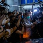 Arrested Hong Kong media tycoon tells staff to 'fight on'