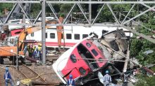 'Why?' asks Taiwan mourner, after 18 killed in train disaster