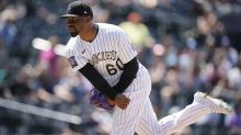 Reds acquire reliever Givens from Rockies for 2 prospects