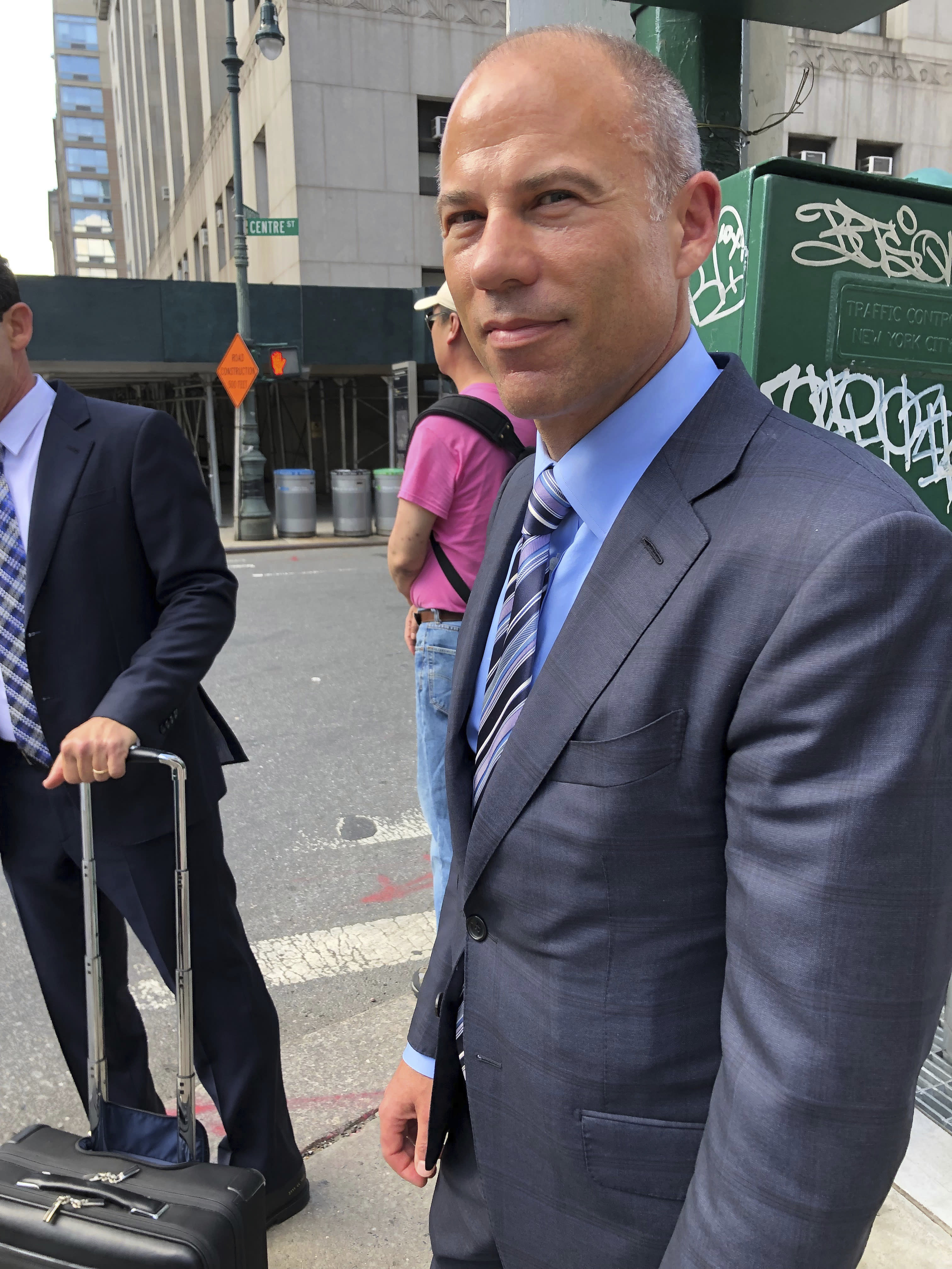 Attorney Michael Avenatti waits for a taxi near the federal courthouse in New York after making an appearance related to the extortion charges against him, Thursday, Aug. 22, 2019. (AP Photo/Larry Neumeister)