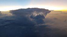 Pilot films stunning moment sun rises over a thunderstorm