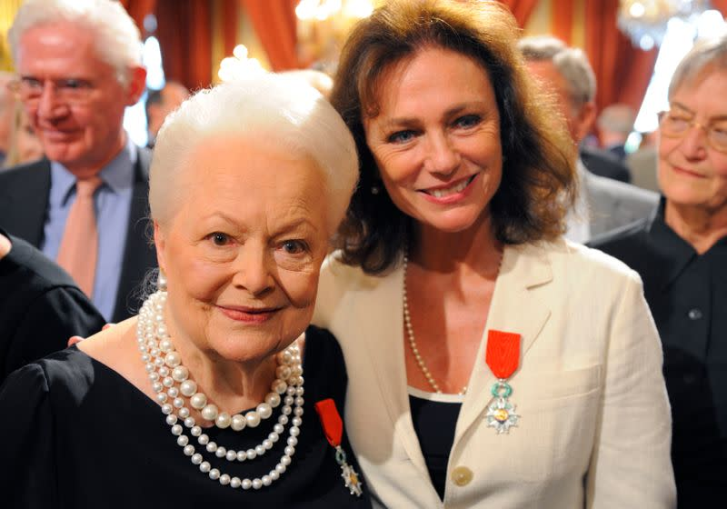 Actresses Bisset and de Havilland pose together after they were awarded with the Legion d'honneur in Paris