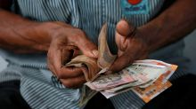 More trouble ahead for bruised rupee: Reuters poll