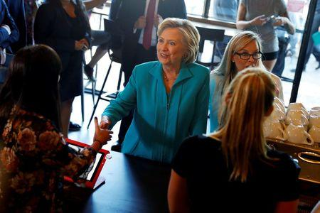 Democratic presidential nominee Hillary Clinton greets supporters at Hub Coffee Roasters in Reno