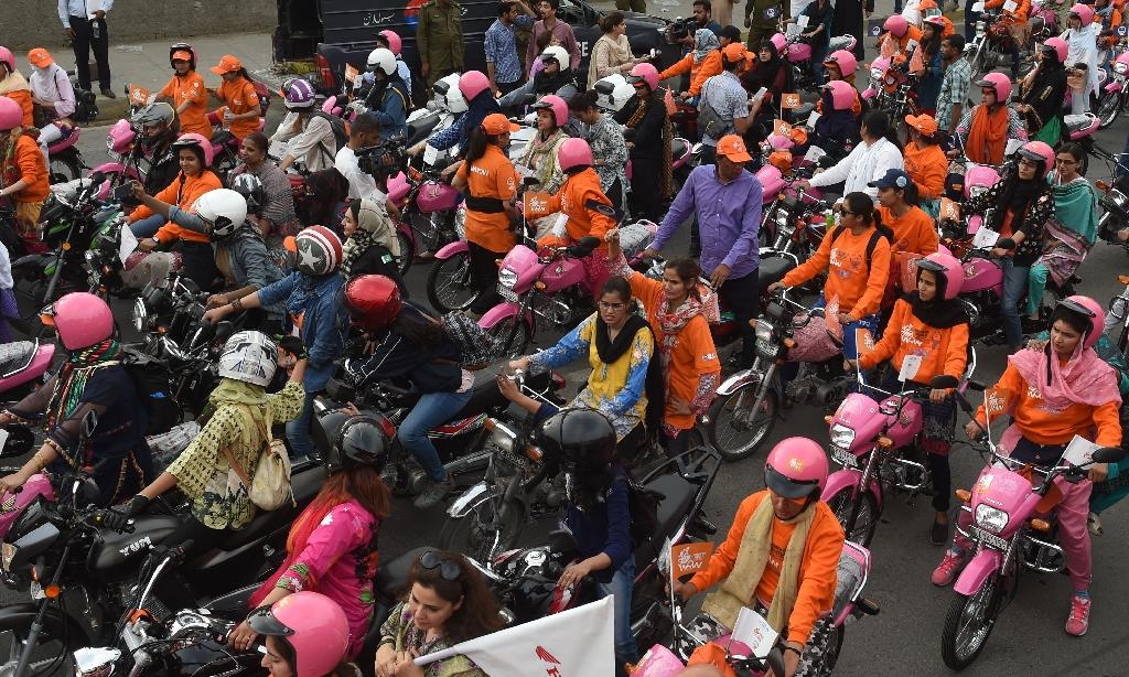 On Sunday the latest batch of dozens of new riders set out to challenge perceptions in Lahore (AFP Photo/ARIF ALI)