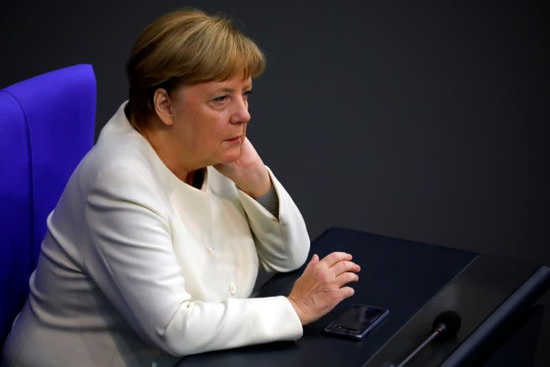 FILE PHOTO: German Chancellor Angela Merkel attends a session of the Bundestag, in Berlin